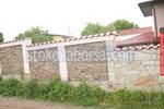 огради с камъни зидани