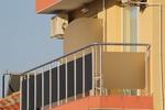 балконски парапети от инокс и черно стъкло по поръчка