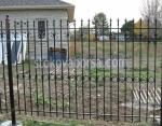 изработка на кована висока ограда